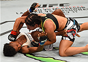 MEXICO CITY, MEXICO - JUNE 13:  Tecia Torres of the United States (top) punches Angela Hill of the United States in their women's strawweight bout during the UFC 188 event at the Arena Ciudad de Mexico on June 13, 2015 in Mexico City, Mexico. (Photo by Josh Hedges/Zuffa LLC/Zuffa LLC via Getty Images)