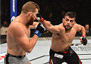 MEXICO CITY, MEXICO - JUNE 13:  (R-L) Kelvin Gastelum of the United States punches Nate Marquardt of the United States in their middleweight bout during the UFC 188 event at the Arena Ciudad de Mexico on June 13, 2015 in Mexico City, Mexico. (Photo by Josh Hedges/Zuffa LLC/Zuffa LLC via Getty Images)