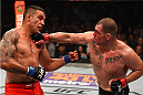 MEXICO CITY, MEXICO - JUNE 13:   (R-L) Cain Velasquez of the United States punches Fabricio Werdum of Brazil in their UFC heavyweight championship bout during the UFC 188 event inside the Arena Ciudad de Mexico on June 13, 2015 in Mexico City, Mexico. (Photo by Josh Hedges/Zuffa LLC/Zuffa LLC via Getty Images)
