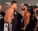 BERLIN, GERMANY - JUNE 19:   (L-R) Opponents Scott Askham of England and Antonio dos Santos of Brazil face off during the UFC Berlin weigh-in at the O2 World on June 19, 2015 in Berlin, Germany. (Photo by Josh Hedges/Zuffa LLC/Zuffa LLC via Getty Images)