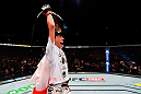 BERLIN, GERMANY - JUNE 20:  UFC women's strawweight champion Joanna Jedrzejczyk of Poland celebrates after defeating Jessica Penne of the United States in their women's strawweight championship bout during the UFC Fight Night event at the O2 World on June 20, 2015 in Berlin, Germany. (Photo by Josh Hedges/Zuffa LLC/Zuffa LLC via Getty Images)