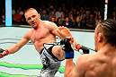 BERLIN, GERMANY - JUNE 20:  (L-R) Dennis Siver of Germany kicks Tatsuya Kawajiri of Japan in their featherweight bout during the UFC Fight Night event at the O2 World on June 20, 2015 in Berlin, Germany. (Photo by Josh Hedges/Zuffa LLC/Zuffa LLC via Getty Images)