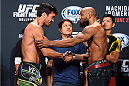 HOLLYWOOD, FL - JUNE 26:  (L-R) Lyoto Machida of Brazil and Yoel Romero of Cuba shakes hands after facing off during the UFC weigh-in at the Seminole Hard Rock Casino on June 26, 2015 in Hollywood, Florida. (Photo by Josh Hedges/Zuffa LLC/Zuffa LLC via Getty Images)