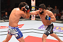 HOLLYWOOD, FL - JUNE 27:   (R-L) Sirwan Kakai of Sweden punches Danny Martinez in their bantamweight during the UFC Fight Night event at the Hard Rock Live on June 27, 2015 in Hollywood, Florida. (Photo by Josh Hedges/Zuffa LLC/Zuffa LLC via Getty Images)