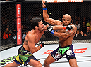 HOLLYWOOD, FL - JUNE 27:  (L-R) Lyoto Machida of Brazil punches Yoel Romero of Cuba in their middleweight during the UFC Fight Night event at the Hard Rock Live on June 27, 2015 in Hollywood, Florida. (Photo by Josh Hedges/Zuffa LLC/Zuffa LLC via Getty Images)