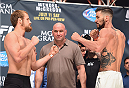 LAS VEGAS, NV - JULY 10:  (L-R) Gunnar Nelson and Brandon Thatch face off during the UFC 189 weigh-in inside MGM Grand Garden Arena on July 10, 2015 in Las Vegas, Nevada.  (Photo by Josh Hedges/Zuffa LLC/Zuffa LLC via Getty Images)
