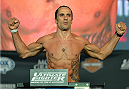 LAS VEGAS, NEVADA - JULY 11:   Josh Samman steps onto the scale during the TUF 21 Finale Weigh-in at the UFC Fan Expo in the Sands Expo and Convention Center on July 11, 2015 in Las Vegas Nevada. (Photo by Brandon Magnus/Zuffa LLC/Zuffa LLC via Getty Images)