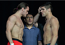 LAS VEGAS, NEVADA - JULY 11:   (L-R) Michael Graves and Vicente Luque face off during the TUF 21 Finale Weigh-in at the UFC Fan Expo in the Sands Expo and Convention Center on July 11, 2015 in Las Vegas Nevada. (Photo by Brandon Magnus/Zuffa LLC/Zuffa LLC via Getty Images)