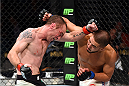 LAS VEGAS, NV - JULY 11:  (L-R) Neil Seery punches Louis Smolka in their flyweight fight during the UFC 189 event inside MGM Grand Garden Arena on July 11, 2015 in Las Vegas, Nevada.  (Photo by Josh Hedges/Zuffa LLC/Zuffa LLC via Getty Images) *** Local Caption *** Neil Seery; Louis Smolka