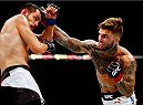 LAS VEGAS, NV - JULY 11:  (R-L) Cody Garbrandt punches Henry Briones in their bantamweight fight during the UFC 189 event inside MGM Grand Garden Arena on July 11, 2015 in Las Vegas, Nevada.  (Photo by Christian Petersen/Zuffa LLC/Zuffa LLC via Getty Images) *** Local Caption *** Cody Garbrandt; Henry Briones