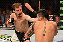 LAS VEGAS, NV - JULY 11:  (L-R) Brad Pickett punches Thomas Almeida in their bantamweight fight during the UFC 189 event inside MGM Grand Garden Arena on July 11, 2015 in Las Vegas, Nevada.  (Photo by Josh Hedges/Zuffa LLC/Zuffa LLC via Getty Images) *** Local Caption *** Brad Pickett; Thomas Almeida