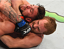 LAS VEGAS, NV - JULY 11:  Gunnar Nelson (bottom) attempts to submit Brandon Thatch in their welterweight fight during the UFC 189 event inside MGM Grand Garden Arena on July 11, 2015 in Las Vegas, Nevada.  (Photo by Josh Hedges/Zuffa LLC/Zuffa LLC via Getty Images) *** Local Caption *** Gunnar Nelson; Brandon Thatch