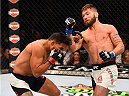 LAS VEGAS, NV - JULY 11:  (R-L) Jeremy Stephens punches Dennis Bermudez in their featherweight fight during the UFC 189 event inside MGM Grand Garden Arena on July 11, 2015 in Las Vegas, Nevada.  (Photo by Josh Hedges/Zuffa LLC/Zuffa LLC via Getty Images) *** Local Caption *** Dennis Bermudez; Jeremy Stephens
