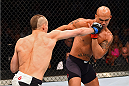 LAS VEGAS, NV - JULY 11:  (L-R) Rory MacDonald punches Robbie Lawler in their UFC welterweight title fight during the UFC 189 event inside MGM Grand Garden Arena on July 11, 2015 in Las Vegas, Nevada.  (Photo by Josh Hedges/Zuffa LLC/Zuffa LLC via Getty Images) *** Local Caption *** Robbie Lawler; Rory MacDonald