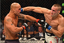 LAS VEGAS, NV - JULY 11:  (R-L) Rory MacDonald punches Robbie Lawler in their UFC welterweight title fight during the UFC 189 event inside MGM Grand Garden Arena on July 11, 2015 in Las Vegas, Nevada.  (Photo by Josh Hedges/Zuffa LLC/Zuffa LLC via Getty Images) *** Local Caption *** Robbie Lawler; Rory MacDonald