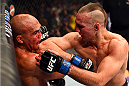 LAS VEGAS, NV - JULY 11:  (R-L) Rory MacDonald elbows Robbie Lawler in their UFC welterweight title fight during the UFC 189 event inside MGM Grand Garden Arena on July 11, 2015 in Las Vegas, Nevada.  (Photo by Josh Hedges/Zuffa LLC/Zuffa LLC via Getty Images) *** Local Caption *** Robbie Lawler; Rory MacDonald