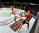 LAS VEGAS, NV - JULY 11:  (L-R) Conor McGregor kicks Chad Mendes in their UFC interim featherweight title fight during the UFC 189 event inside MGM Grand Garden Arena on July 11, 2015 in Las Vegas, Nevada.  (Photo by Josh Hedges/Zuffa LLC/Zuffa LLC via Getty Images) *** Local Caption *** Chad Mendes; Conor McGregor