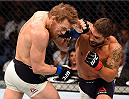 LAS VEGAS, NV - JULY 11:  (R-L) Chad Mendes punches Conor McGregor in their UFC interim featherweight title fight during the UFC 189 event inside MGM Grand Garden Arena on July 11, 2015 in Las Vegas, Nevada.  (Photo by Josh Hedges/Zuffa LLC/Zuffa LLC via Getty Images) *** Local Caption *** Chad Mendes; Conor McGregor