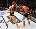 LAS VEGAS, NV - JULY 11:  (L-R) Conor McGregor punches Chad Mendes in their UFC interim featherweight title fight during the UFC 189 event inside MGM Grand Garden Arena on July 11, 2015 in Las Vegas, Nevada.  (Photo by Josh Hedges/Zuffa LLC/Zuffa LLC via Getty Images) *** Local Caption *** Chad Mendes; Conor McGregor