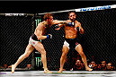 LAS VEGAS, NV - JULY 11:  (L-R) Conor McGregor punches Chad Mendes in their UFC interim featherweight title fight during the UFC 189 event inside MGM Grand Garden Arena on July 11, 2015 in Las Vegas, Nevada.  (Photo by Christian Petersen/Zuffa LLC/Zuffa LLC via Getty Images) *** Local Caption *** Chad Mendes; Conor McGregor