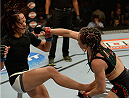 LAS VEGAS, NV - JULY 12:  (R-L) Angela Magana punches Michelle Waterson in their women's strawweight bout during the Ultimate Fighter Finale inside MGM Grand Garden Arena on July 12, 2015 in Las Vegas, Nevada.  (Photo by Brandon Magnus/Zuffa LLC/Zuffa LLC via Getty Images)