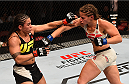 SAN DIEGO, CA - JULY 15:   (R-L) Sarah Moras of Canada punches Jessica Andrade of Brazil in their women's bantamweight bout during the UFC event at the Valley View Casino Center on July 15, 2015 in San Diego, California. (Photo by Jeff Bottari/Zuffa LLC/Zuffa LLC via Getty Images)