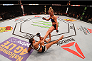SAN DIEGO, CA - JULY 15:   Holly Holm (top) kicks Marion Reneau in their women's bantamweight bout during the UFC event at the Valley View Casino Center on July 15, 2015 in San Diego, California. (Photo by Jeff Bottari/Zuffa LLC/Zuffa LLC via Getty Images)