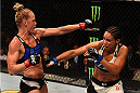 SAN DIEGO, CA - JULY 15:   (L-R) Holly Holm exchanges punches with Marion Reneau in their women's bantamweight bout during the UFC event at the Valley View Casino Center on July 15, 2015 in San Diego, California. (Photo by Jeff Bottari/Zuffa LLC/Zuffa LLC via Getty Images)