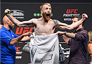 GLASGOW, SCOTLAND - JULY 17:  Paddy Holohan of Ireland steps on the scale during the UFC weigh-in inside the SSE Hydro on July 17, 2015 in Glasgow, Scotland.  (Photo by Josh Hedges/Zuffa LLC/Zuffa LLC via Getty Images)