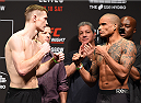GLASGOW, SCOTLAND - JULY 17:  (L-R) Opponents Joe Duffy of Ireland and Ivan Jorge of Brazil face off during the UFC weigh-in inside the SSE Hydro on July 17, 2015 in Glasgow, Scotland.  (Photo by Josh Hedges/Zuffa LLC/Zuffa LLC via Getty Images)