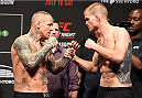 GLASGOW, SCOTLAND - JULY 17:  (L-R) Opponents Ross Pearson of England and Evan Dunham of the United States face off during the UFC weigh-in inside the SSE Hydro on July 17, 2015 in Glasgow, Scotland.  (Photo by Josh Hedges/Zuffa LLC/Zuffa LLC via Getty Images)