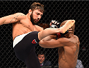 GLASGOW, SCOTLAND - JULY 18:  (L-R) Jimmie Rivera of the United States kicks Marcus Brimage of the United States in their bantamweight fight during the UFC Fight Night event inside the SSE Hydro on July 18, 2015 in Glasgow, Scotland.  (Photo by Josh Hedges/Zuffa LLC/Zuffa LLC via Getty Images)