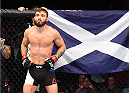 GLASGOW, SCOTLAND - JULY 18:  Robert Whiteford of Scotland stands in the Octagon before his featherweight fight against Paul Redmond of Ireland during the UFC Fight Night event inside the SSE Hydro on July 18, 2015 in Glasgow, Scotland.  (Photo by Josh Hedges/Zuffa LLC/Zuffa LLC via Getty Images)