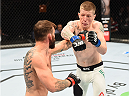 GLASGOW, SCOTLAND - JULY 18:  (L-R) Robert Whiteford of Scotland punches Paul Redmond of Ireland in their featherweight fight during the UFC Fight Night event inside the SSE Hydro on July 18, 2015 in Glasgow, Scotland.  (Photo by Josh Hedges/Zuffa LLC/Zuffa LLC via Getty Images)