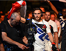 GLASGOW, SCOTLAND - JULY 18:  Mickael Lebout of France enters the arena before his lightweight fight against Teemu Packalen of Finland during the UFC Fight Night event inside the SSE Hydro on July 18, 2015 in Glasgow, Scotland.  (Photo by Josh Hedges/Zuffa LLC/Zuffa LLC via Getty Images)