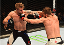 GLASGOW, SCOTLAND - JULY 18:  (L-R) Teemu Packalen of Finland punches Mickael Lebout of France in their lightweight fight during the UFC Fight Night event inside the SSE Hydro on July 18, 2015 in Glasgow, Scotland.  (Photo by Josh Hedges/Zuffa LLC/Zuffa LLC via Getty Images)