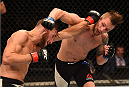 GLASGOW, SCOTLAND - JULY 18:  (L-R) Mickael Lebout of France and Teemu Packalen of Finland trade punches in their lightweight fight during the UFC Fight Night event inside the SSE Hydro on July 18, 2015 in Glasgow, Scotland.  (Photo by Josh Hedges/Zuffa LLC/Zuffa LLC via Getty Images)