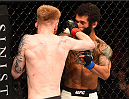 GLASGOW, SCOTLAND - JULY 18:  (L-R) Paddy Holohan of Ireland punches Vaughan Lee of England in their flyweight fight during the UFC Fight Night event inside the SSE Hydro on July 18, 2015 in Glasgow, Scotland.  (Photo by Josh Hedges/Zuffa LLC/Zuffa LLC via Getty Images)