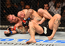GLASGOW, SCOTLAND - JULY 18:  (L-R) Evan Dunham of the United States attempts to secure a rear choke submission against Ross Pearson of England in their lightweight fight during the UFC Fight Night event inside the SSE Hydro on July 18, 2015 in Glasgow, Scotland.  (Photo by Josh Hedges/Zuffa LLC/Zuffa LLC via Getty Images)
