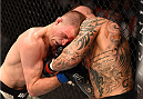 GLASGOW, SCOTLAND - JULY 18:  (R-L) Ross Pearson of England punches Evan Dunham of the United States in their lightweight fight during the UFC Fight Night event inside the SSE Hydro on July 18, 2015 in Glasgow, Scotland.  (Photo by Josh Hedges/Zuffa LLC/Zuffa LLC via Getty Images)