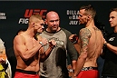 CHICAGO, IL - JULY 24:   (L-R) Opponents Daron Cruickshank and James Krause face off during the UFC weigh-in at the United Center on July 24, 2015 in Chicago, Illinois. (Photo by Rey Del Rio/Zuffa LLC/Zuffa LLC via Getty Images)