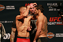 CHICAGO, IL - JULY 24:   (L-R) TJ Dillashaw and Renan Barao of Brazil face off during the UFC weigh-in at the United Center on July 24, 2015 in Chicago, Illinois. (Photo by Rey Del Rio/Zuffa LLC/Zuffa LLC via Getty Images)