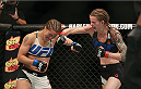 CHICAGO, IL - JULY 25:   Jessamyn Duke punches Elizabeth Phillips in their women's bantamweight bout during the UFC event at the United Center on July 25, 2015 in Chicago, Illinois. (Photo by Rey Del Rio/Zuffa LLC/Zuffa LLC via Getty Images)