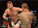 CHICAGO, IL - JULY 25:   (L-R) Bryan Caraway punches Eddie Wineland in their bantamweight bout during the UFC event at the United Center on July 25, 2015 in Chicago, Illinois. (Photo by Jeff Bottari/Zuffa LLC/Zuffa LLC via Getty Images)
