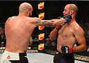 CHICAGO, IL - JULY 25:   (L-R) Ben Saunders punches Kenny Robertson in their welterweight bout during the UFC event at the United Center on July 25, 2015 in Chicago, Illinois. (Photo by Jeff Bottari/Zuffa LLC/Zuffa LLC via Getty Images)