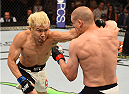 CHICAGO, IL - JULY 25:   (L-R) Takanori Gomi of Japan punches Joe Lauzon in their lightweight bout during the UFC event at the United Center on July 25, 2015 in Chicago, Illinois. (Photo by Jeff Bottari/Zuffa LLC/Zuffa LLC via Getty Images)