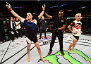 CHICAGO, IL - JULY 25:   Joe Lauzon (L) reacts after his knockout victory over Takanori Gomi of Japan in their lightweight bout during the UFC event at the United Center on July 25, 2015 in Chicago, Illinois. (Photo by Jeff Bottari/Zuffa LLC/Zuffa LLC via Getty Images)