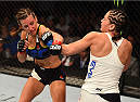 CHICAGO, IL - JULY 25:   (L-R) Miesha Tate punches Jessica Eye in their women's bantamweight bout during the UFC event at the United Center on July 25, 2015 in Chicago, Illinois. (Photo by Jeff Bottari/Zuffa LLC/Zuffa LLC via Getty Images)