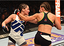 CHICAGO, IL - JULY 25:   (R-L) Miesha Tate and Jessica Eye trade punches in their women's bantamweight bout during the UFC event at the United Center on July 25, 2015 in Chicago, Illinois. (Photo by Jeff Bottari/Zuffa LLC/Zuffa LLC via Getty Images)