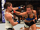 CHICAGO, IL - JULY 25:   (R-L) Miesha Tate punches Jessica Eye in their women's bantamweight bout during the UFC event at the United Center on July 25, 2015 in Chicago, Illinois. (Photo by Jeff Bottari/Zuffa LLC/Zuffa LLC via Getty Images)